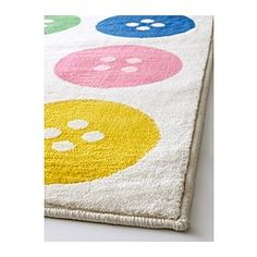 PURCHASED!!! TÅSTRUP Rug, low pile - IKEA. $50   Ohhhh, I so, so like this button rug.  Perfect for my sewing room!