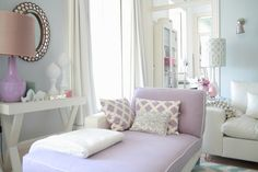 I like all the pillows, the white sofa behind the purple, and especially the fun lamp shade near the white sofa!
