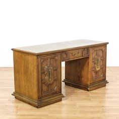 """This """"Stanley"""" desk is featured in a solid wood with a glossy walnut stained finish. This kneehole desk has 2 intricate carved panel doors, 5 drawers and an interior cabinet. Timeless desk perfect for a home office! #americantraditional #desks #kneeholedesk #sandiegovintage #vintagefurniture"""