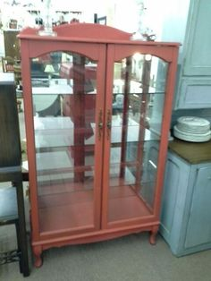 $169 - This is a double door curio cabinet painted red. Glass doors, glass sides, and heavy glass shelves. The cabinet has a mirror back to help show off your collectibles.  It measures 35 inches across the front and 15 inches deep.  It stands approximately 60 inches at the tallest point.  This curio cabinet can be seen in booth D 17 at Main Street Antique Mall 7260 East Main St ( E of Power Rd ) Mesa 85207 480 9241122 open 7 days 10 till 530 Cash or charge 30 day layaway also available