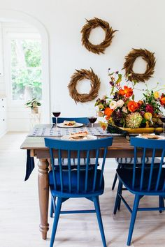 Thanksgiving table ideas (loving the wreaths and pop of blue with the chairs!)