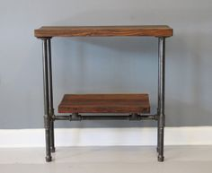 Reclaimed Wood Urban Console Table w/ Industrial Pipe Legs. Dark Walnut Finish. Built by Hand. Guaranteed for Life. Ships for Free. via Etsy