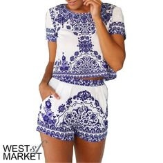 -IN STOCK ALL SIZES-  Crop Two-Piece Crop top and short set in a beautiful blue & white porcelain print! Material is high quality and stretchy- NOT SEE THROUGH! Sizes M, L, and XL coming back soon!! PLEASE COMMENT TO BUY THIS LISTING with the SIZE you would like, I will make a separate listing for you! West Market SF Pants Jumpsuits & Rompers