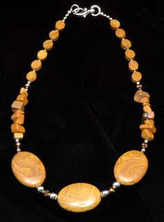 In an old childrens story a bunch of tigers hold onto each others tails and run around in a circle so fast they melt into a pool of rich creamy butter. Thats the look of tawny golden tiger skin jasper. That combination is so rich looking, youll feel positively decadent when you wear it.