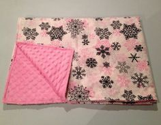 Handmade pink snowflake minky baby blanket, perfect baby shower gift for the winter baby girl in your life. Wrap your adorable newborn in this super cuddly soft blanket, and snuggle them with love.  https://www.etsy.com/ca/listing/259745571/sale-pink-snowflake-minky-baby-blanket
