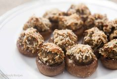 Classic stuffed mushrooms with shallots, garlic, walnuts, breadcrumbs, chopped mushroom stems, and Parmesan. A perfect holiday party appetizer! On SimplyRecipes.com