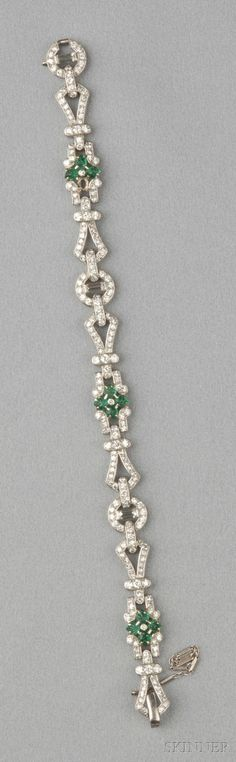ART DECO PLATINUM, CARVED EMERALD, AND DIAMOND BRACELET, SET WITH CARVED EMERALD LEAVES, FURTHER SET WITH BAGUETTE-, OLD EUROPEAN-, ... - by nadine