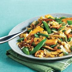 Tofu and Spring Vegetable Stir-Fry—Golden pan-fried tofu is right at home alongside fresh, crisp spring produce. Make this dinner a weekly staple by switching up the veggies and using whatever you have in the fridge. Yummy Vegetable Recipes, Lunch Recipes, Healthy Dinner Recipes, Vegetarian Recipes, Weeknight Recipes, Broccoli Recipes, Tofu Recipes, Vegan Meals, Healthy Cooking