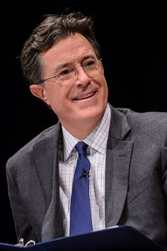 I hate Stephen Colbert. This guy is a completely unfunny douche bag!