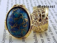 #Arty Oval #Ring #Blue #Gold Drizzle Knuckle Art #AvantGarde Statement #Designerstyle #Celebritystyle #jewelry #fashion #modtoast