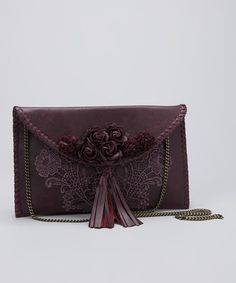 Love this embellished plum purse!