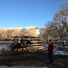 Cowboys working in the round pen at Zapata Ranch. Come and join us for a ranch vacation! #ZapataRanch
