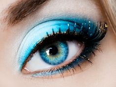 Flakes of gold make-up in her lashes picks up the highlights in her eyes.  Beautiful!
