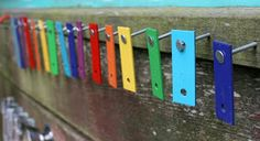 Music wall in your backyard: recycled xylophones, wind chimes, wooden spoons, pipes, industrial items, etc. Looks so fun!