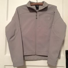 Grey Hard Shell Zip Up Fantastic condition. Perfect for chilly Spring days. Hard shell exterior, soft fleece interior. Just purchased last week from another Posher and unfortunately doesn't fit (in need of a larger size). Otherwise, I would love to keep it! She'll; 97% polyester, 3% Elastane. Lining A: 100% Polyester, Lining B: 85% Nylon, 15% Elastane. Asking the same price I paid. North Face Jackets & Coats