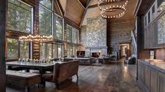 Home of the Day: Living large in a lodge on Lake Arrowhead  This contemporary-style lodge makes the most of its location on Lake Arrowhead, Calif., framing lake and mountain views through towering walls of windows. Three stories of living space feature soaring ceilings and wooden beams, wrought iron finishes and stone fireplaces in nearly every room. A...  http://www.latimes.com/business/realestate/hot-property/la-fi-hotprop-lake-arrowhead-lodge-20150522-story.html