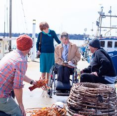 Jehovah's Witnesses preach to people on a boat dock