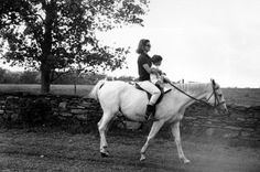 First lady Jacqueline Kennedy holds her son John F. Kennedy Jr. as she rides towards her family's home at Hammersmith Farm, where she spent her vacation, on Sept. 12, 1962, near Newport, R.I. Photo: Associated Press / Associated Press #soRIhistory, #soRI