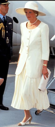 Diana wore all white on her 10th wedding anniversary in July 1991 in Lincolnshire, England.