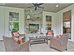 Indoor Outdoor Fireplace in cute covered porch with paneled walls and ceiling - . - Indoor Outdoor Fireplace in cute covered porch with paneled walls and ceiling – Estately - See Through Fireplace, Outside Fireplace, Porch Fireplace, Porch Wall, Fireplace Cover, Living Room With Fireplace, Fireplace Ideas, Fireplace Candles, Basement Fireplace