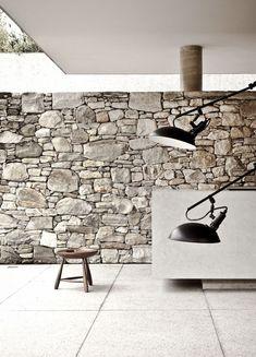 Rough stone wall vs. clean lines. Marcio Kogan. House 6.: