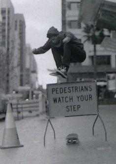 Amazing Ollie over a sidewalk sign