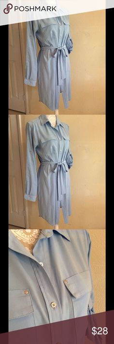 Baby blue shirt dress, long sleeve or roll 'em up. Great details, so pretty in light blue silky fabric silver baby buttons and pocket studs. I wore this open with a tank and jeans for a casual look. It is slightly sheer if wearing to work-I recommend a slip.  97% poly/ 3% spandex. falls just above the knee Calvin Klein Dresses Mini