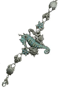#Seahorse and #Shell #Bracelet by artist Mary DeMarco.  http://www.wildlifewonders.com/seahorses.html