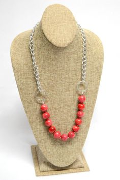 This necklace is handmade using Red Coral Beads and Aluminum Chain. It measures 26 3/4.