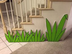 Magalie Sarnataro's props Jungle vignette Grass cutouts glued wrapping paper