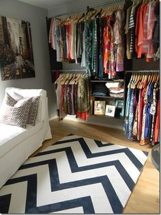 open closets can be tricky but they're great for those of us with little or no closet space. A well edited wardrobe and unified hangers make this particular closet work!