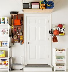 Love the pegboard by the door for brooms and things!  And the plastic vegetable bins.
