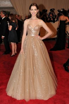 At the 2010 Costume Institute gala, Hathaway glowed in a strapless nude glittering Valentino dress.