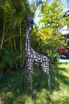 As seen on season 5 of The Vanilla Ice Project, the beachfront backyard is dressed up with a handful of exotic sculptures, including this cute wrought iron giraffe.