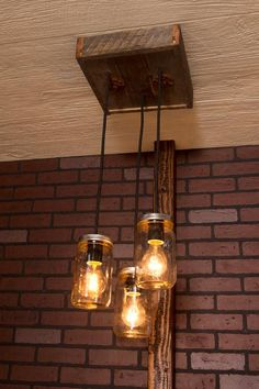 "Repurposed, reclaimed, upcycled, recycled, you can call it what you like but the elegant, yet rustic look of reclaimed wood allows it to seamlessly blend in any style, from Modern to Rustic and everything in between, This unique Mason Jar Chandelier is handcrafted and mixes in the crisp glow of the bulbs encompassed in their mason jars and you are sure to leave your friends asking where you found your new prize.Approximate Canopy Dimensions: 12"" x 12"" x 3""Bottom of longest pendant is…"
