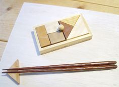 Wooden puzzle chopstick rest Japanese Chopsticks, Chopstick Rest, Asia, Material Things, Wooden Puzzles, Cutlery, Hanger, Marble, Carving