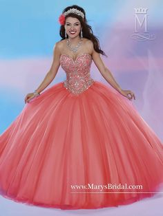 This strapless tulle quinceanera ball gown with sweetheart neckline is beautiful in blue, coral, mint, or cloud. The beaded bodice and lace-up back add stunning detail.