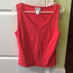 Pink Ann Taylor tank top In excellent condition with no rips or stains. Ann Taylor loft tank top. Length is 23 inches and armpit to armpit measures 17 inches across. Soft and stretchy! 100% cotton. Thanks for looking. Ann Taylor Tops Tank Tops