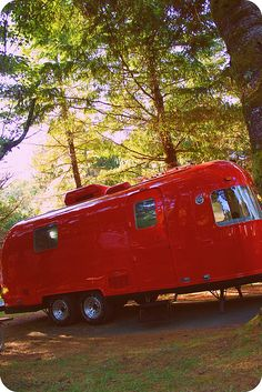Bright Red AirStream!  Yea!  I love AirStreams and love the bright red - different but I love it.  AirStream is my desired travel trailer.  Someday...