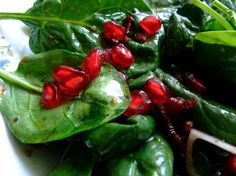 spinach salad with pomegranite-just got a new recipe with spinach, toasted pine nuts, sea salt, red onion, avocado, balsamic...yum!