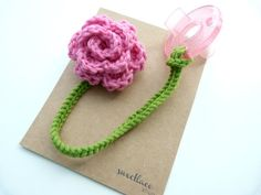 Hey, I found this really awesome Etsy listing at http://www.etsy.com/listing/122183524/pacifier-clip-any-color-crochet-flower