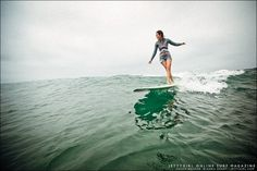Kassia Meador testing out her early wetsuit designs at Cardiff Reef. Surf photo by Chris Grant, Jettygirl Online Surf Magazine.