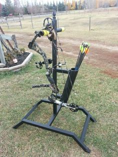 """My DIY Bow Stand. Made it out of 1 1/2"""" thin square metal tubing and a 3"""" PVC pipe for the quiver. It can hold 2 bows and about 3 dozen arrows."""