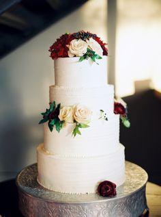 Burgundy and cream rose topped wedding cake: http://www.stylemepretty.com/2015/11/24/elegant-fall-wedding-in-an-old-textile-factory/ | Photography: Kate Ignatoskwi - http://www.kateignatowski.com/
