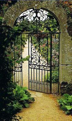 Elegant gate leading to a beautiful garden. France