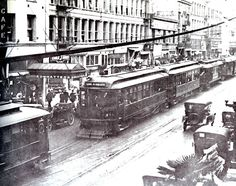 This shot from the 1920s shows a Pacific Electric train caught in a jam with three Los Angeles Railway streetcars.