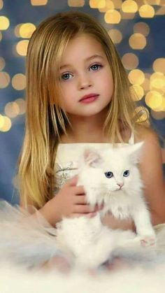 .adirable little girl & a white kitty.