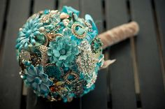 @Danielle Taylor - I saw you mention broach bouquets and thought of you when I saw this.  There is also a picture of the way the cake is displayed that is gorgeous and sort of up your alley.