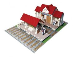 Construction kit with real bricks of a train station. The building blocks can be reused because the cement is dissolved in water. Contains: construction bricks, cement , wood building components, spatula, bowl, plate and a foam board with figures.