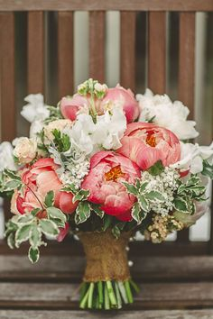Garden flowers bouquet bride bridal flowers peonies summer relaxed rustic coral peony barn wedding http:www. Coral Peonies, Peonies Bouquet, Coral Pink, Pink Color, Flower Bouquets, Coral Charm Peony, Purple Bouquets, Purple Rose, Brooch Bouquets